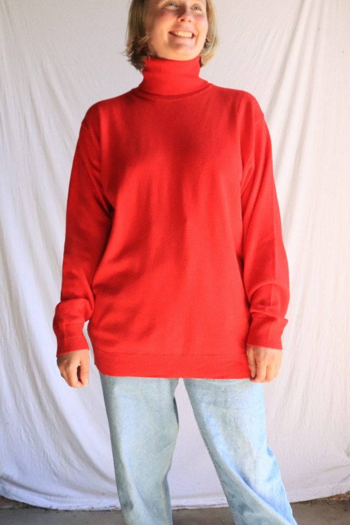 Red wool roll neck jumper