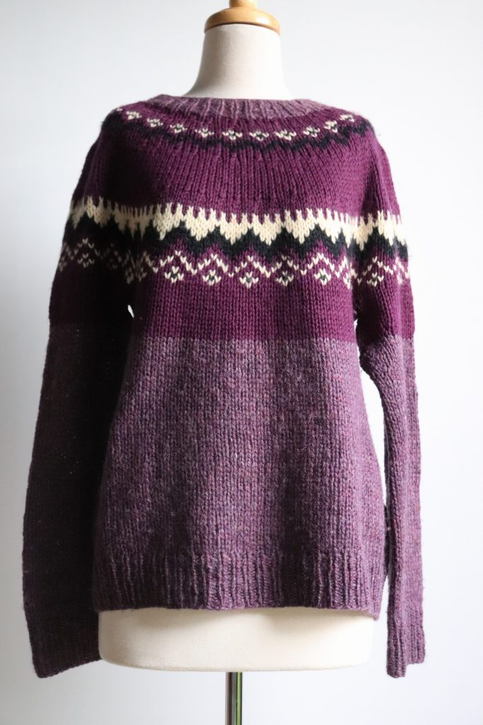 Purple hand knitted jumper
