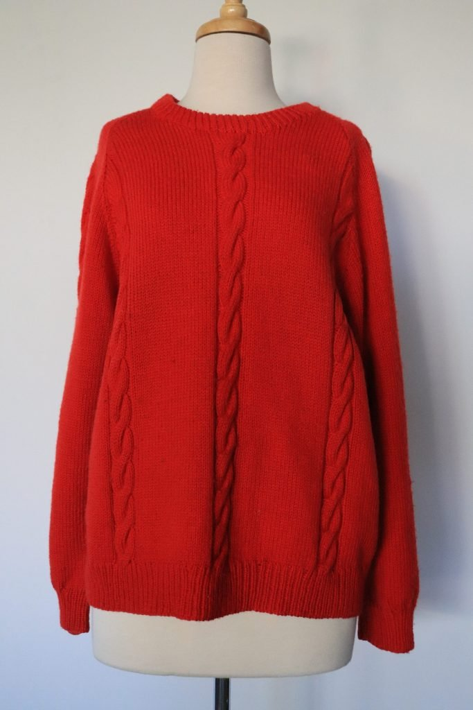 Red hand knitted wool jumper
